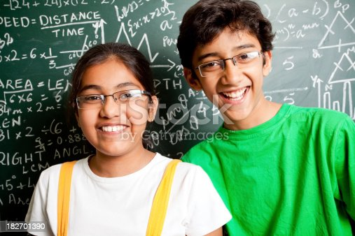 istock Cheerful Indian Teenager Boy and Girl Student with Mathematics Problems 182701390