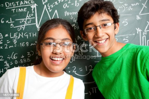 istock Cheerful Indian Teenager Boy and Girl Student with Mathematics Problems 182703855
