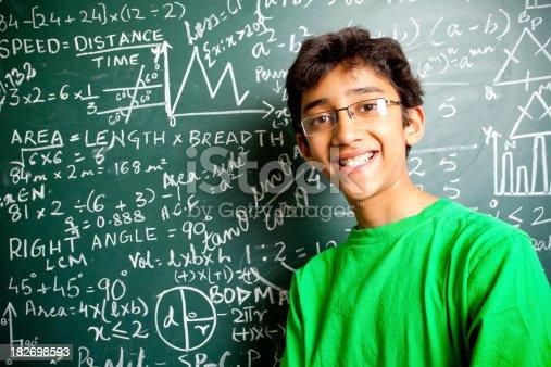 istock Cheerful Indian Teenager Boy Student with Mathematics Problems Horizontal 182698593