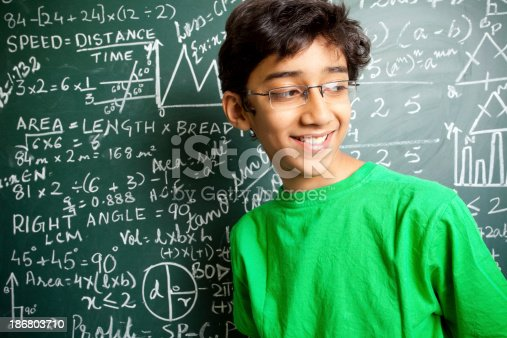 istock Cheerful Indian Teenager Boy Student with Mathematics Problems 186803710