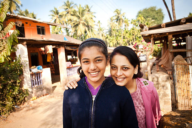 cheerful indian teenager girl with her mom holidaying in village - village stock photos and pictures