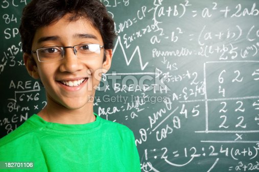 istock Cheerful Indian Teenager Student with Mathematics Problems 182701106