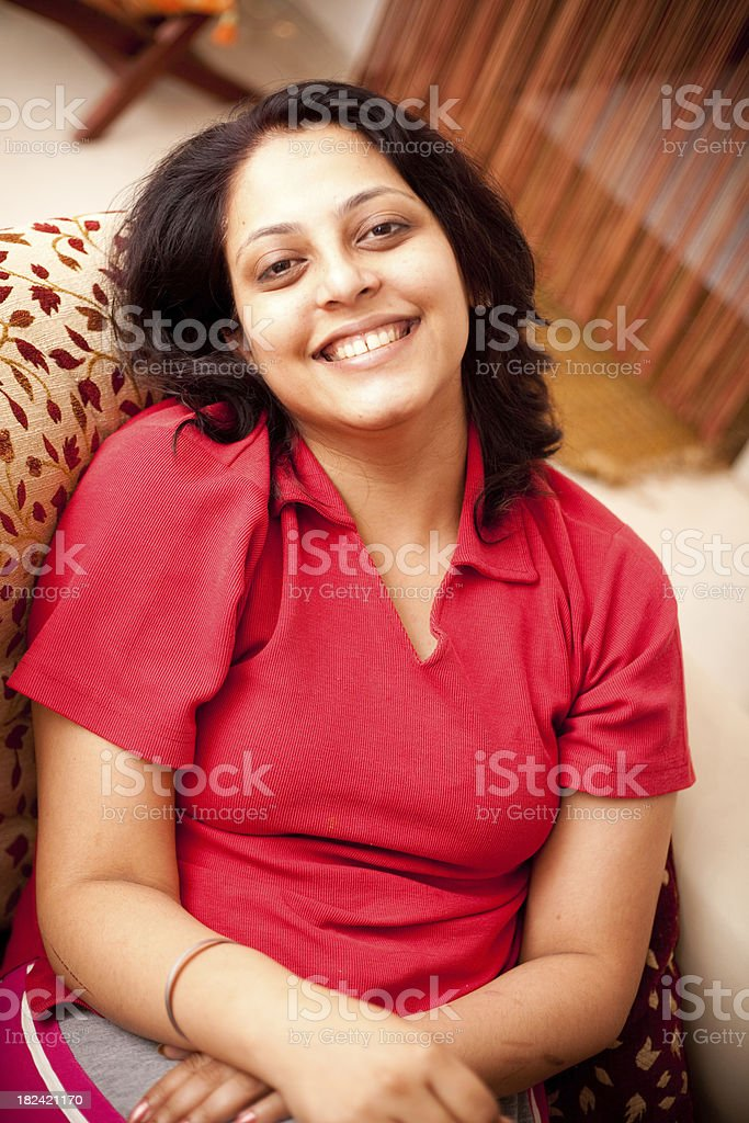 Cheerful Indian Woman relaxing at her home leisure vertical royalty-free stock photo