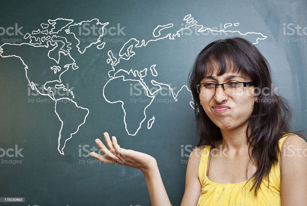 Cheerful Indian woman Standing with Hand drawn World map royalty-free stock photo