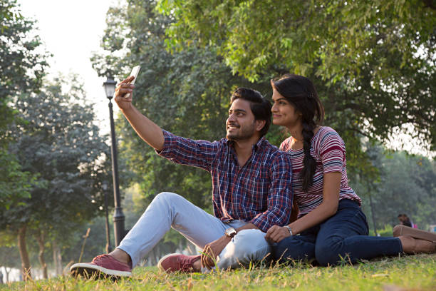 Cheerful Indian young couple - Stock image Indian Ethnicity, Couple - Relationship, Asian and Indian Ethnicities romance stock pictures, royalty-free photos & images