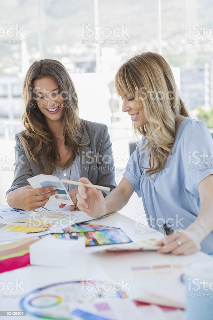 Cheerful interior designer working together royalty-free stock photo