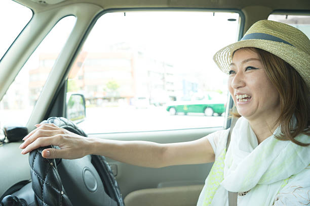 Top Asian Woman Driver Car Stock Photos, Pictures And Images - Istock-3474