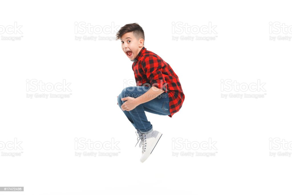 Cheerful jumping boy stock photo