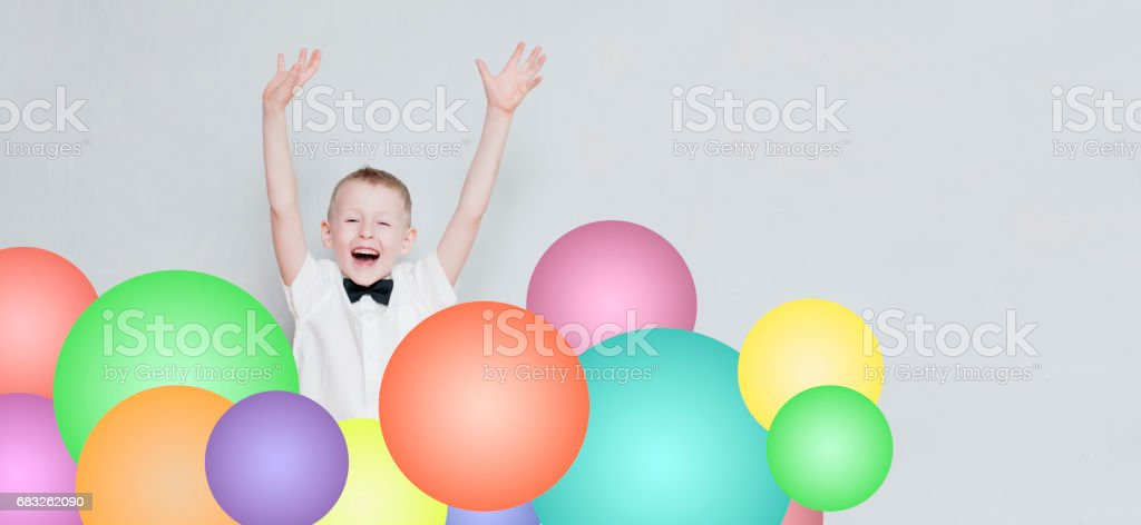 cheerful kid is jumping out from colorful balloons foto de stock royalty-free