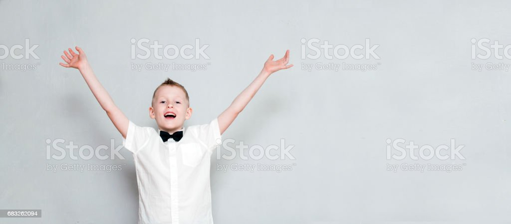 cheerful kid with hands up royalty-free stock photo