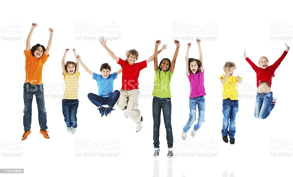 Cheerful kids jumping with arms up. stock photo