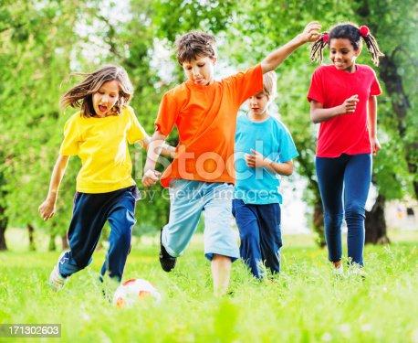 544818734 istock photo Cheerful kids playing football. 171302603