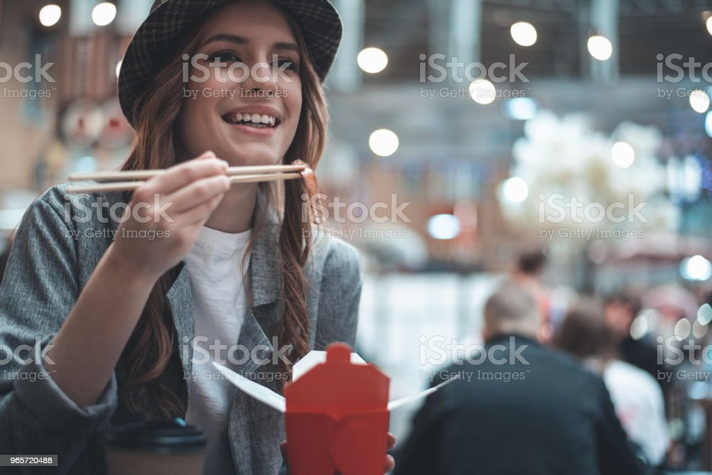 Cheerful lady is eating asian meals - Royalty-free Adult Stock Photo