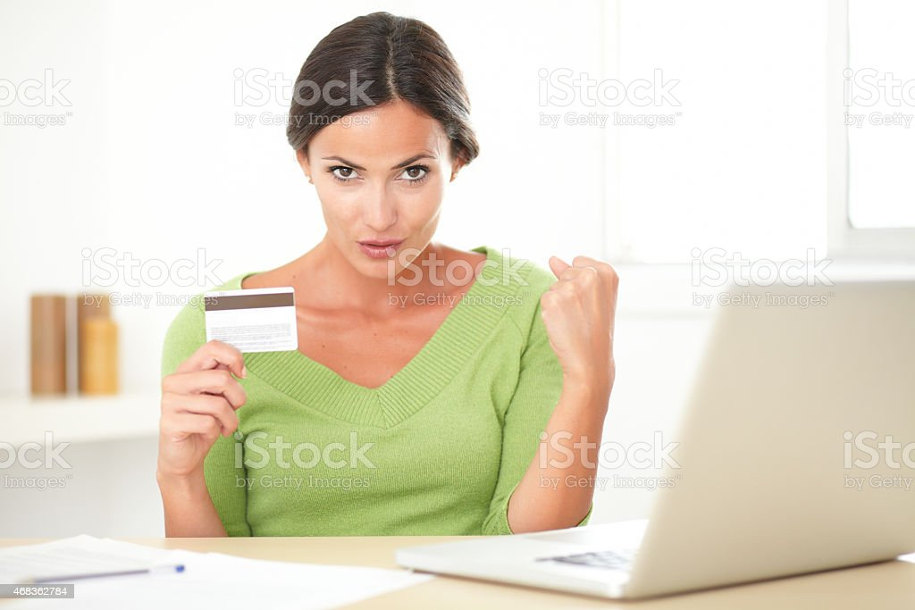Cheerful lady using her laptop for online buying royalty-free stock photo