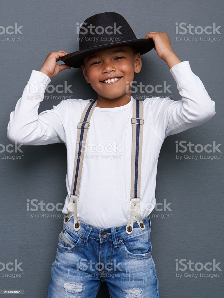 Cheerful little boy smiling with hat stock photo