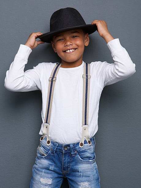 Royalty free boy model pictures images and stock photos istock cheerful little boy smiling with hat stock photo voltagebd Choice Image