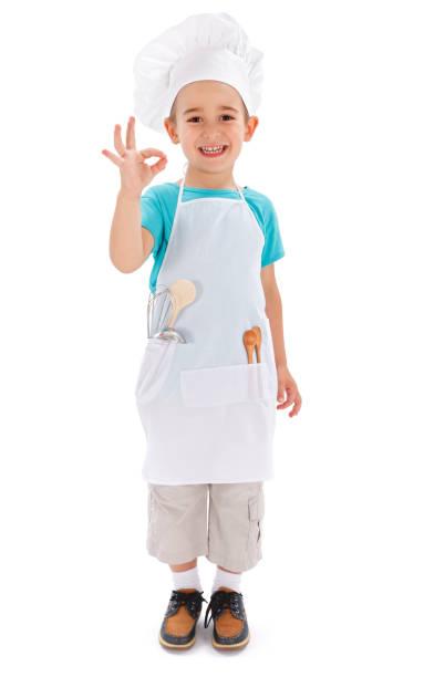 Cheerful little chef showing good taste