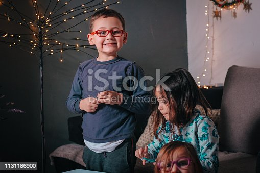 983418152 istock photo Cheerful little children having fun doing finger painting 1131186900