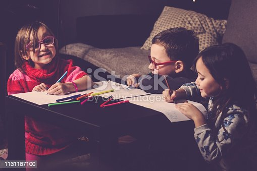 983418152 istock photo Cheerful little children having fun doing finger painting 1131187100