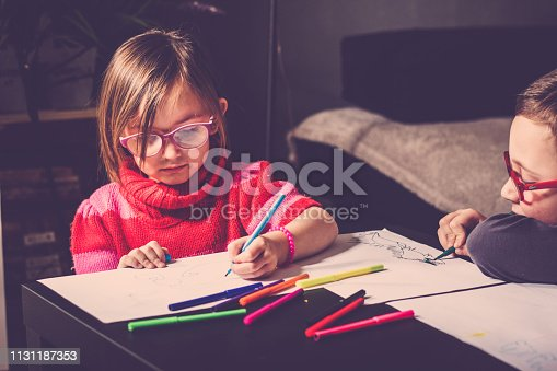 983418152 istock photo Cheerful little children having fun doing finger painting 1131187353
