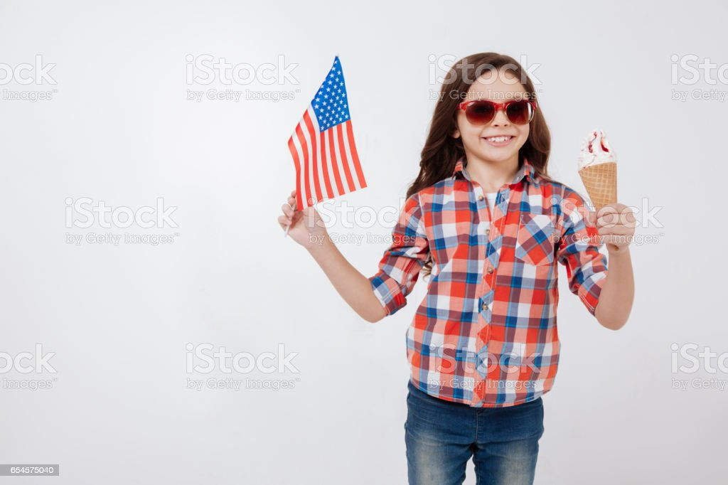 Cheerful little girl celebrating American national holiday stock photo
