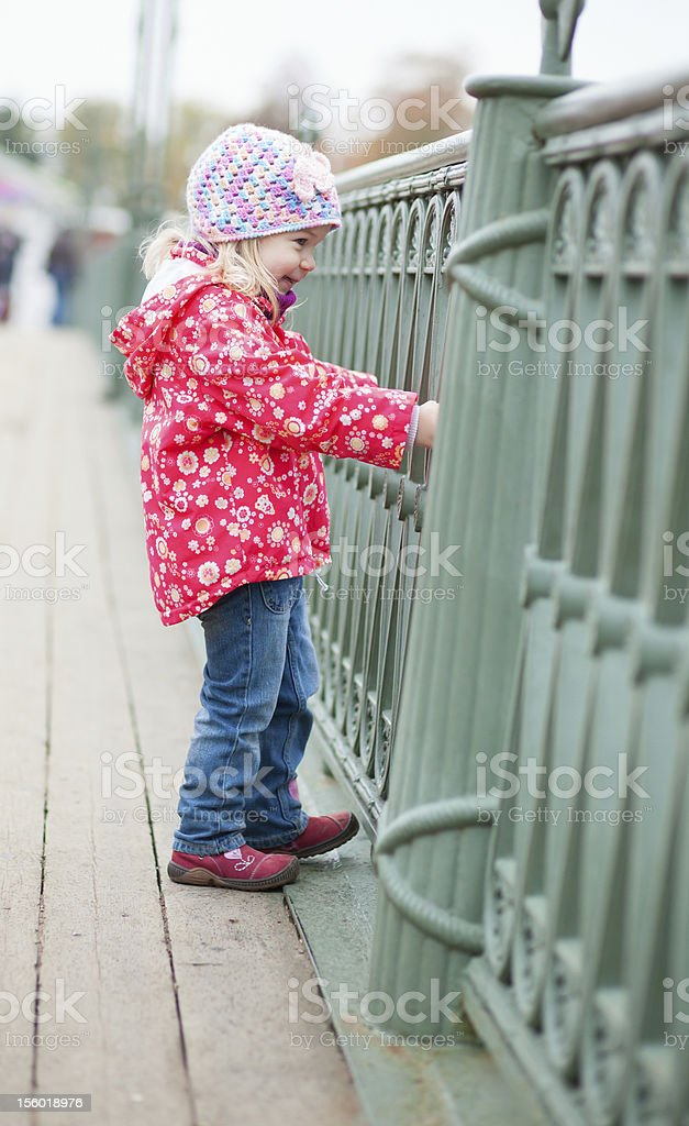 Cheerful little girl close to the grill royalty-free stock photo
