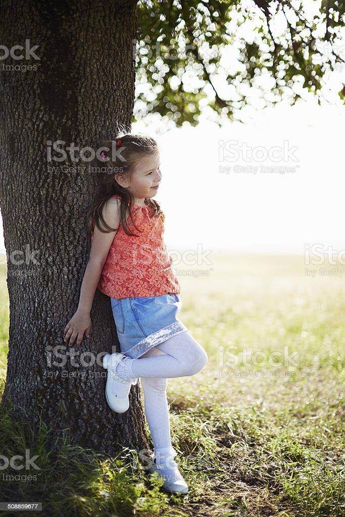 Cheerful little girl enjoying the nature royalty-free stock photo