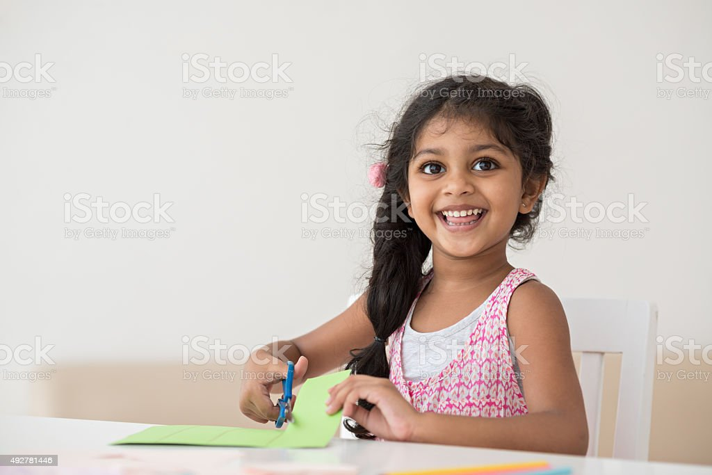 Cheerful little girl Portrait of a smiling cute little girl 2015 Stock Photo