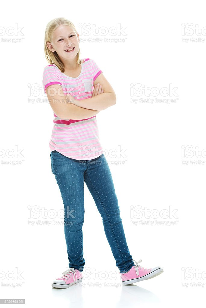 Cheerful Little Girl Standing With Arms Crossed Stock