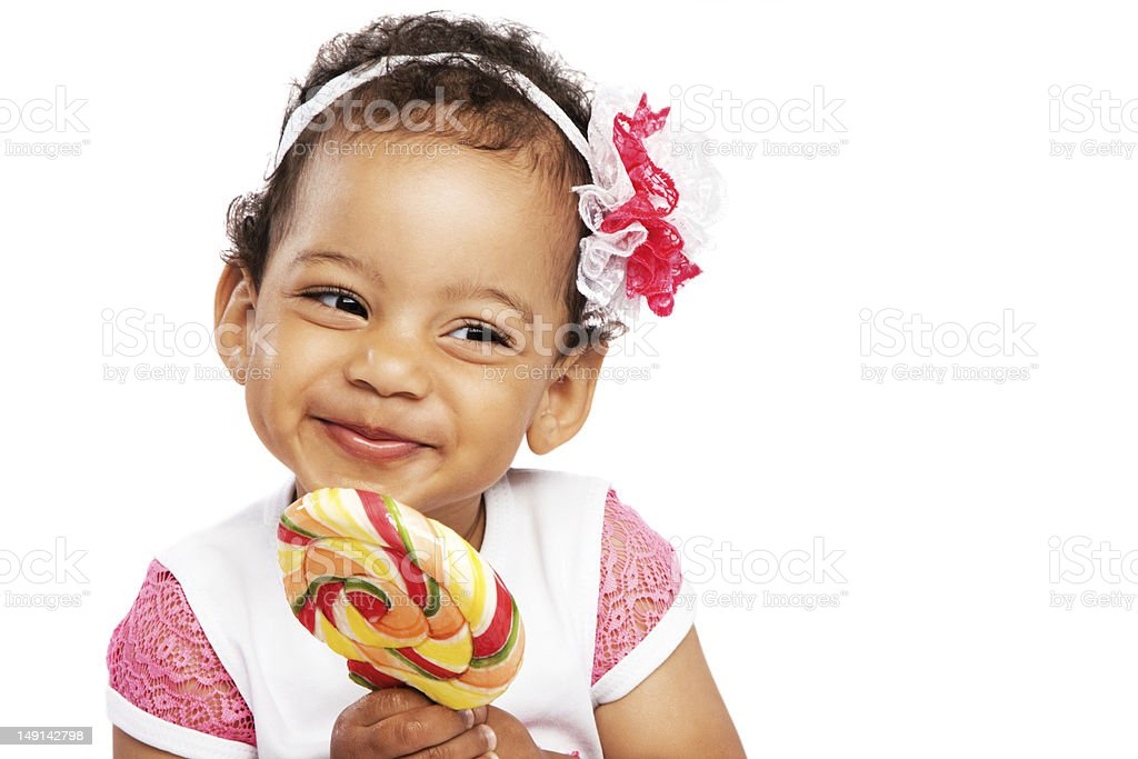Cheerful little girl with a big lollipop stock photo