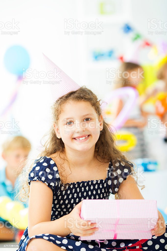 Cheerful Little Girl With Birthday Gift. royalty-free stock photo