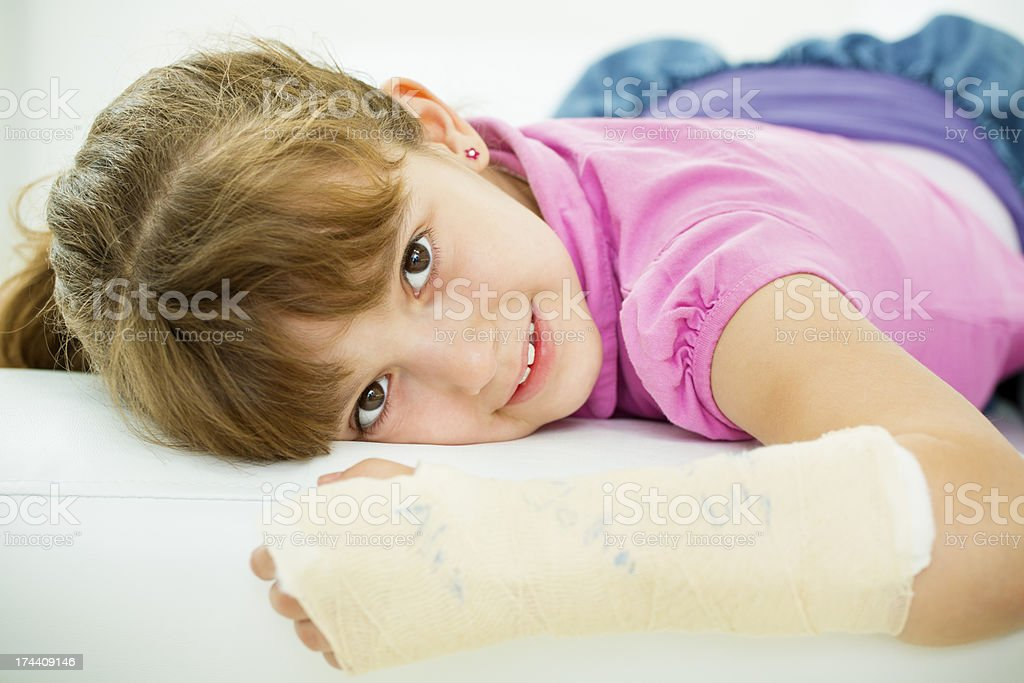 Cheerful Little Girl With Broken Arm. stock photo