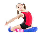 Nice little girl performing gymnastic exercise