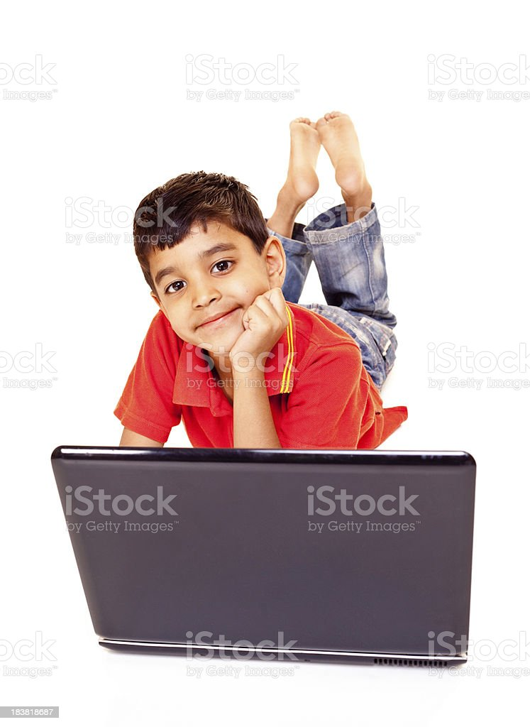 Cheerful Little Indian Boy Using Laptop Isolated on White royalty-free stock photo