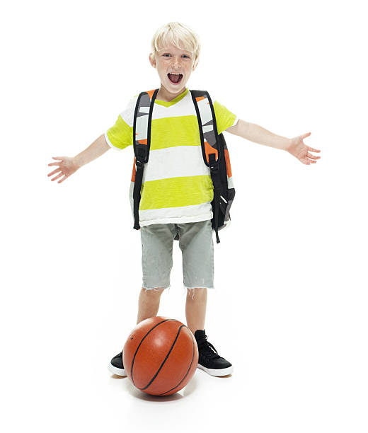 Cheerful little student with arms outstretched stock photo