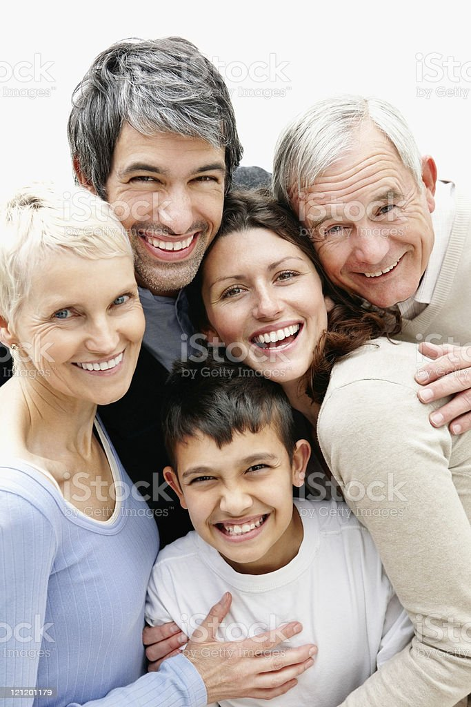 Cheerful loving multi generational family smiling together stock photo