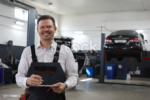 962888586 istock photo Cheerful male at automotive center 1211799870