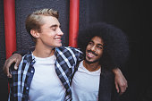 istock Cheerful male friends with arm around 682753190
