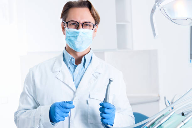 Cheerful male man dentist at dentist office stock photo