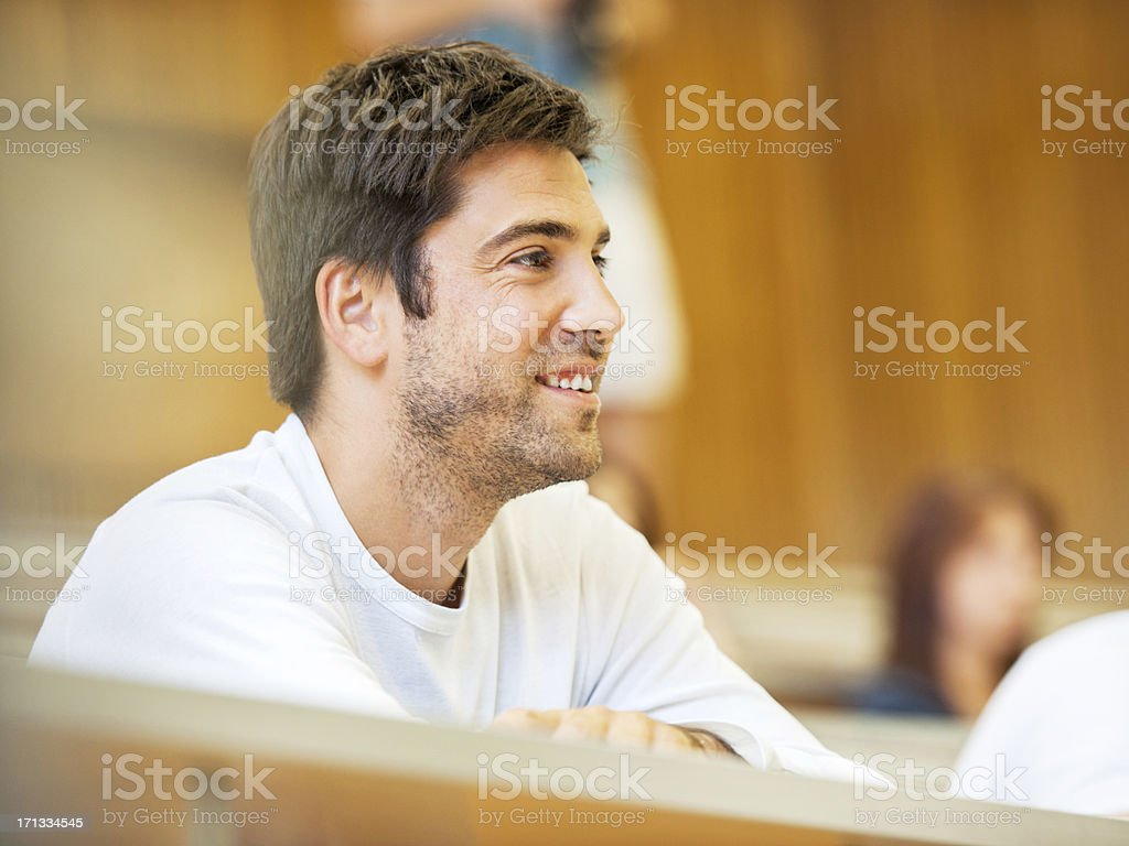 Cheerful male student at amphitheatre. royalty-free stock photo