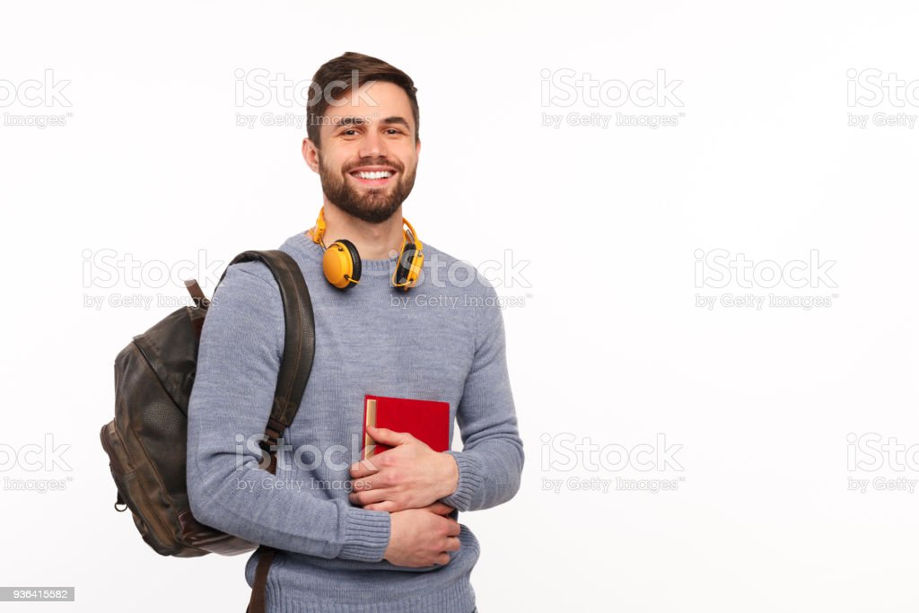 Cheerful male student with backpack stock photo