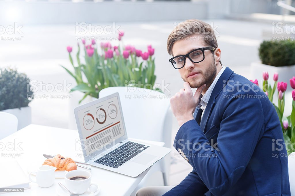 Cheerful male worker is relaxing in restaurant royalty-free stock photo