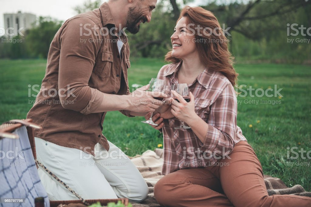 Cheerful man and woman celebrating anniversary in the fresh air - Royalty-free Adult Stock Photo