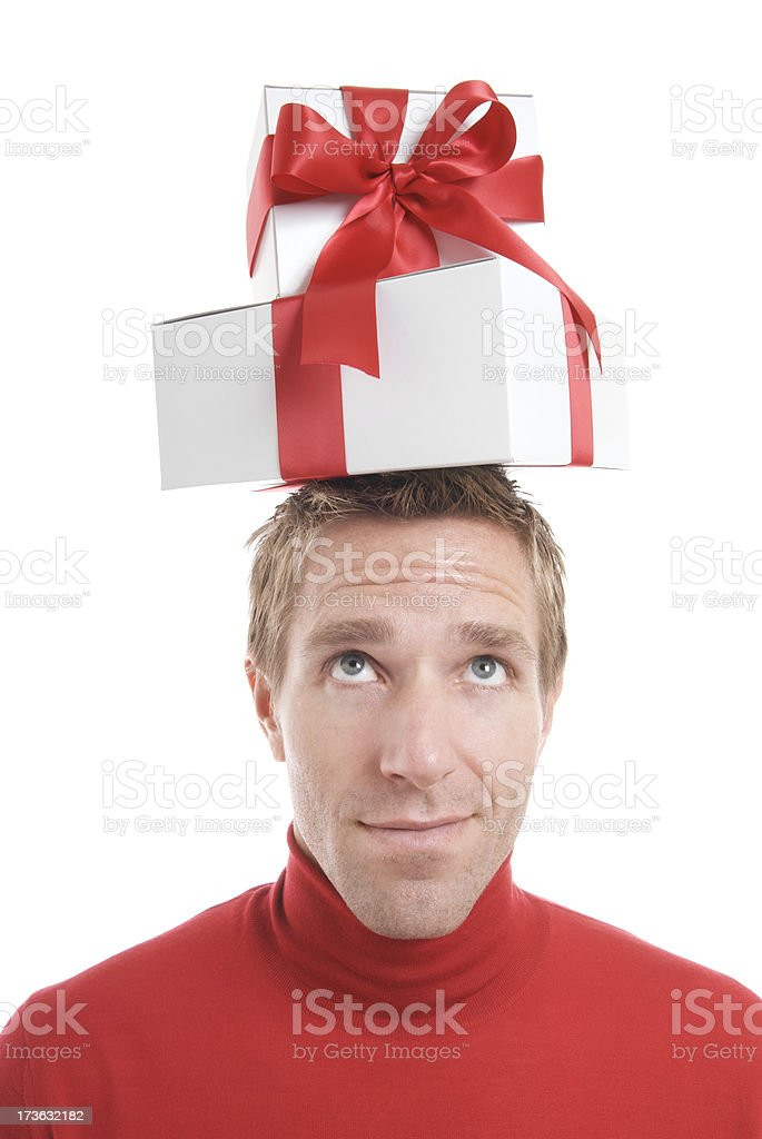Cheerful Man Balances Gifts on Head with Smile White Background royalty-free stock photo