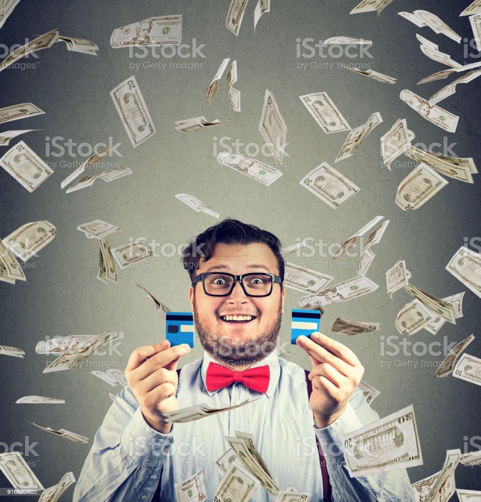 Cheerful man excited with money bonus stock photo