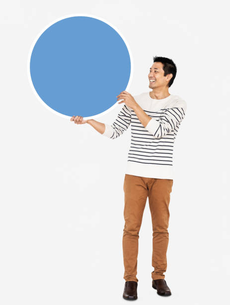 Cheerful man holding a blank blue circle stock photo