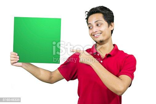 istock Cheerful  man holding green blank placard 516548305