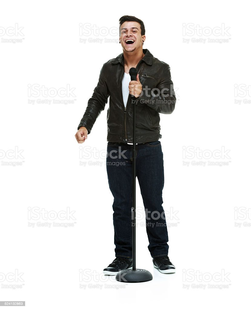 Cheerful man holding microphone stock photo