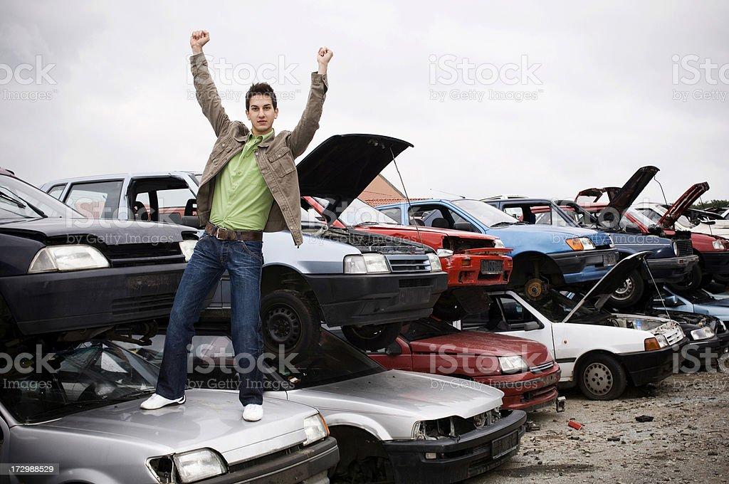 Cheerful man in a junkyard royalty-free stock photo