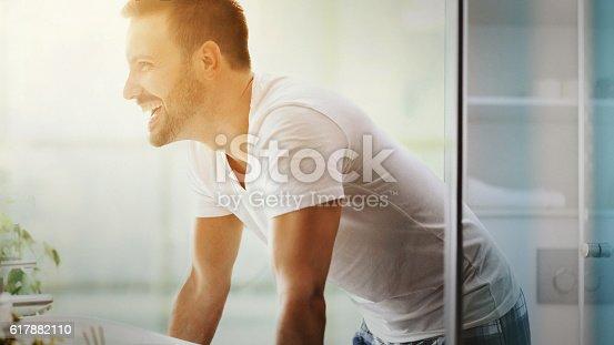 istock Cheerful man in bathroom. 617882110